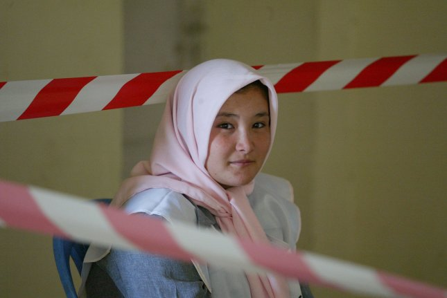 An Afghan poll worker waits for voters at a polling station in Kabul, Afghanistan on August 20, 2009. Afghans voted to elect a new president for the second time in the country's history. UPI/Mohammad Kheirkhah