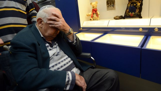 Holocaust survivor Meir Muhlbaum, 83, weeps after looking at the tefillin he donated to the 'Gathering the Fragments' exhibition at the Yad Vashem Holocaust Museum in Jerusalem on International Holocaust Remembrance Day, January 27, 2013. The exhibition displays personal items gather from the Holocaust. The Yad Vashem Holocaust Museum commemorates the six million Jews killed by the Nazis during World War II. UPI/Debbie Hill.