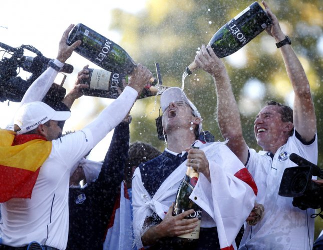 Team Europe's Justin Rose, of England, is doused with champaign after Europe came from behind to defeat the USA 14 1/2 to 13 1/2 at the 39th Ryder Cup at Medinah Country Club on September 30, 2012 in Medinah, Illinois. UPI/Mark Cowan