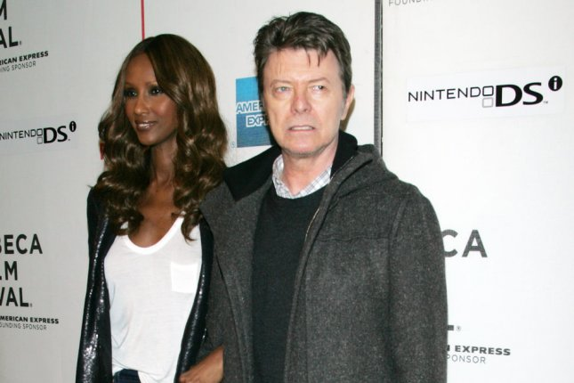 Iman and David Bowie arrive for the Tribeca Film Festival premiere of Moon in New York on April 30, 2009. New music by Bowie is featured in the opening credits of the series The Last Panthers. File Photo by Laura Cavanaugh/UPI