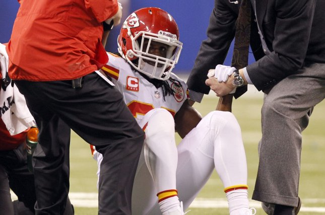 Kansas City Chiefs running back Jamaal Charles (25) is helped off the field. UPI /Mark Cowan