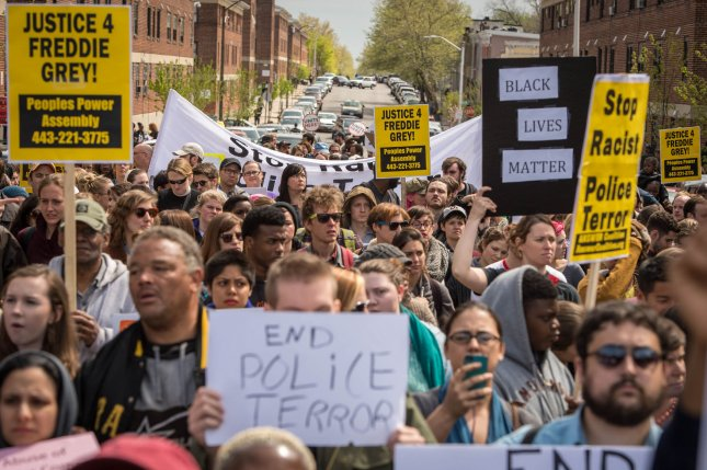 Thousands of people march through the streets of Baltimore, Maryland during a demonstration on April 25, 2015, to protest the mistreatment and ultimate death of Freddie Gray while in police custody. Gray, 25, was arrested on April 12 and died of unexplained spinal injuries while in a police van. File Photo Ken Cedeno/UPI