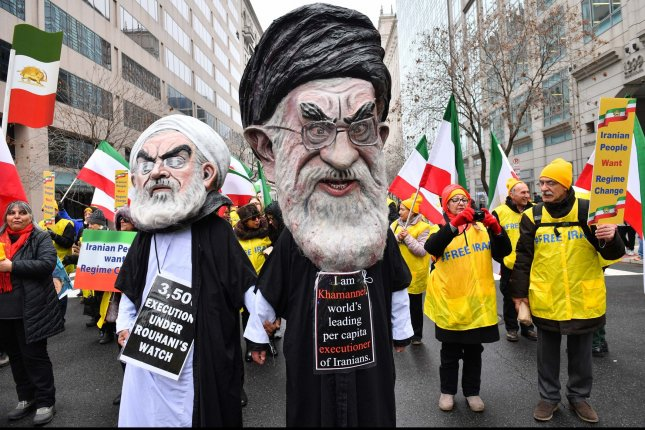 Demonstrations participate in a rally held by the Organization of Iranian-American Communities in support of a regime change in Iran, in Washington, D.C., on March 8. Photo by Kevin Dietsch/UPI