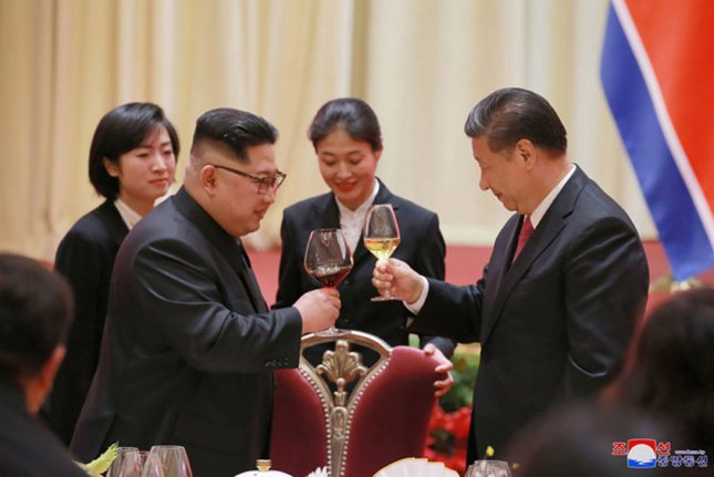 Summits between Kim Jong Un (L) and Chinese President Xi Jinping in 2018 and 2019 have been followed by North Korean statements of support for the Chinese government. File Photo by KCNA/UPI