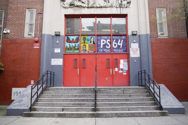 The doors to New York City's P.S. 64 Joseph P. Addabbo are seen closed on May 11. Officials said Wednesday public schools in the city will reopen in September, but students will only be in class for part of each week. File Photo by John Angelillo/UPI
