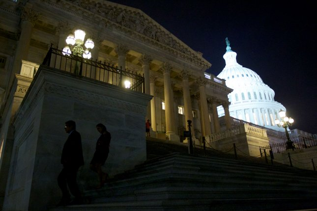 U.S. House Representatives and staff leave after voting at the U.S. Capitol in Washington D.C. October 16, 2013. UPI/Molly Riley