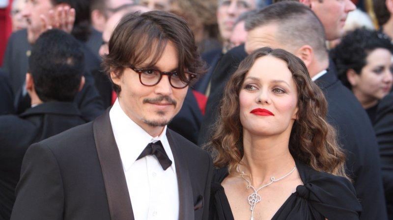 Johnny Depp (L) and Vanessa Paradis in February 24, 2008. (UPI Photo/Terry Schmitt)