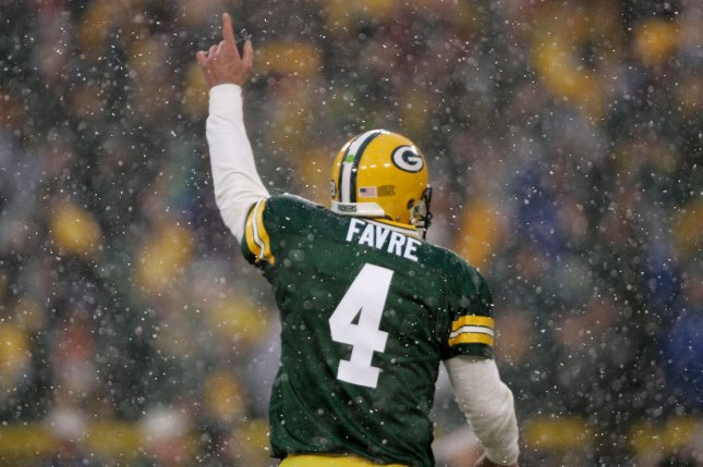 bc923659bcf Former Green Bay Packers quarterback Brett Favre will have his name and  retired No. 4 added to the north facade inside Lambeau Field during a  ceremony on ...