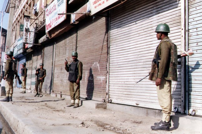 Indian troops guard the streets of Srinagar, the capital of Indian-administered Kashmir, on January 8, 2000. At least three Indian soldiers, including two officers, were killed Sunday on the second day of a stand-off with militants in a town 14 miles south of Srinagar. UPI file photo