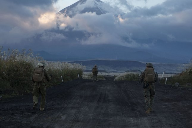 U.S. Marines patrol roads after the ground assault portion of a long-range training raid from Marine Corps Air Station Futenma in Okinawa to the Combined Arms Training Center in Camp Fuji on November 4. The United States will return part of the Okinawa military base to Japan in a December ceremony, the Pentagon said Tuesday. The presence of United States Forces Japan on Okinawa has generated outcry over crimes committed by U.S. personnel. File Photo by Lance Cpl. Kelsey Dornfeld/ U.S. Marine Corps/UPI