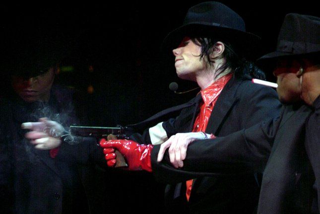 Singer Michael Jackson performs at A Night At The Apollo concert held on April 24, 2002, at New York City Apollo theatre to kick off a nationwide Democratic National Committee voter registration initiative. File Photo by Ezio Petersen/UPI