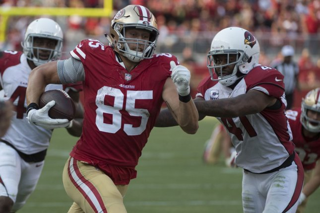 San Francisco 49ers tight end George Kittle (85) is pushed out of bounds by Arizona Cardinals defender Antoine Bethea (41) after taking a pass from quarterback C.J. Beathard 45 yards in the fourth quarter on October 7 at Levi's Stadium in Santa Clara, Calif. Photo by Terry Schmitt/UPI