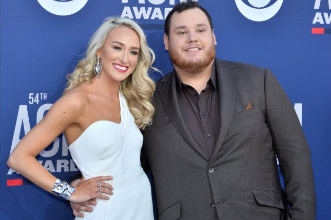 Nicole Hocking (L) and Luke Combs tied the knot in Florida on Saturday. File Photo by Jim Ruymen/UPI