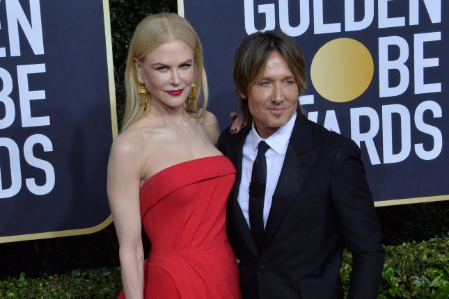 Keith Urban (R), pictured with Nicole Kidman, released a music video for Out the Cage featuring Breland and Nile Rodgers. File Photo by Jim Ruymen/UPI