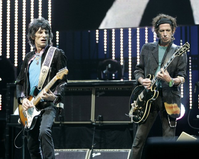 Ron Wood(L) and Keith Richards with the Rolling Stones perform in concert at the Bank Atlantic Center in Sunrise, Florida on March 12, 2006. (UPI Photo/Michael Bush)