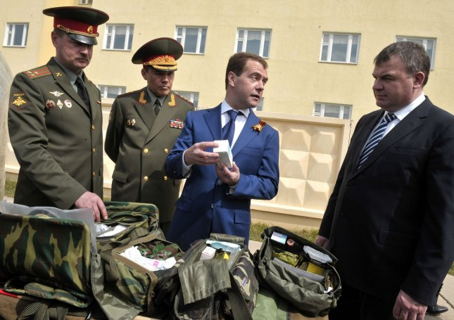 Russian President Dmitry Medvedev (C) and Defense Minister Anatoly Serdyukov (R) visit the 10th Taman brigade outside Moscow on May 5, 2010. UPI/Alex Volgin