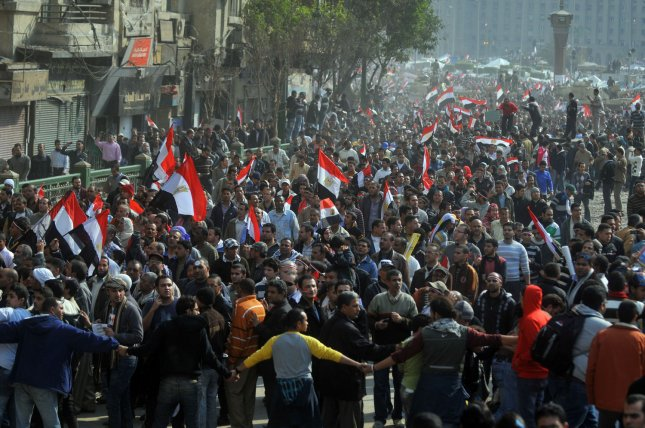 Egyptian anti-government demonstrators flood Cairo's landmark Tahrir Square early in Egypt on February 11, 2011, the 18th day of protests against President Hosni Mubarak. Egyptian President Hosni Mubarak resigned the presidency and turned over power to Vice President Omar Suleiman. UPI