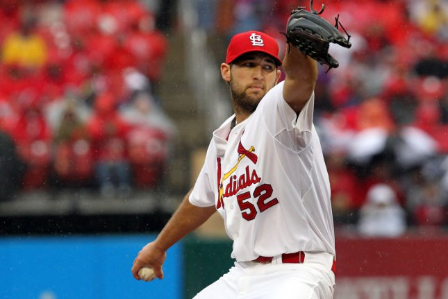St. Louis Cardinals starting pitcher Michael Wacha delivers a pitch to the Cincinnati Reds in the third inning at Busch Stadium on Opening Day in St. Louis on April 7, 2014. UPI/Bill Greenblatt
