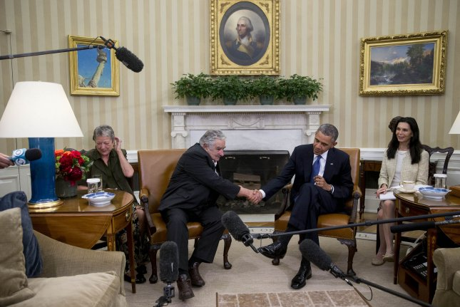 Jose Mujica Cordano, Uruguay's president, left, shakes hands with U.S. President Barack Obama during a bilateral meeting in the Oval Office of the White House in Washington, D.C. on May 12, 2014. UPI/Andrew Harrer/Pool