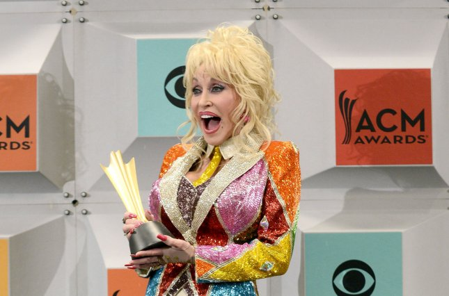 Dolly Parton holds her Tex Ritter award backstage at the 51st annual Academy of Country Music Awards in Las Vegas on April 3, 2016. NBC says it is working on a second TV movie about the country music legend's childhood. File Photo by Jim Ruymen/UPI