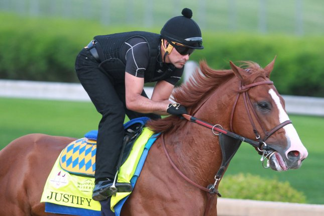 Kentucky Derby favorite Justify gallops on the track during morning workouts on Thursday at Churchill Downs in Louisville, Kentucky. The 144th running of the Kentucky Derby is scheduled for Saturday, May 5. Photo by John Sommers II/UPI
