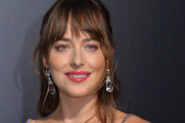 Dakota Johnson's rep denied pregnancy rumors after the actress attended a party festooned with pink and blue balloons. File Photo by Jim Ruymen/UPI