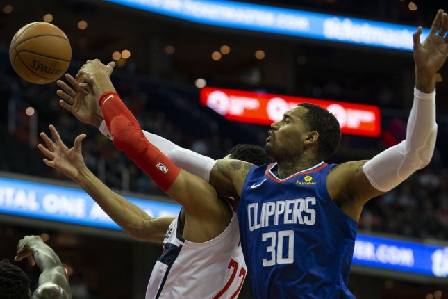 Los Angeles Clippers forward Mike Scott (30) and Washington Wizards forward Otto Porter Jr. (22) battle for a loose ball. Photo by Alex Edelman/UPI