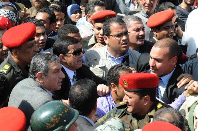 New Egyptian Prime Minister Essam Sharaf (L) is welcomed by thousands of supporters in Cairo's Tahrir Square on March 4, 2011 a day after Essam Sharaf was named New Prime Minister. Friday's protest, which was meant to press for change, turned into a massive celebration following news that Shafiq had been replaced by Sharaf. UPI