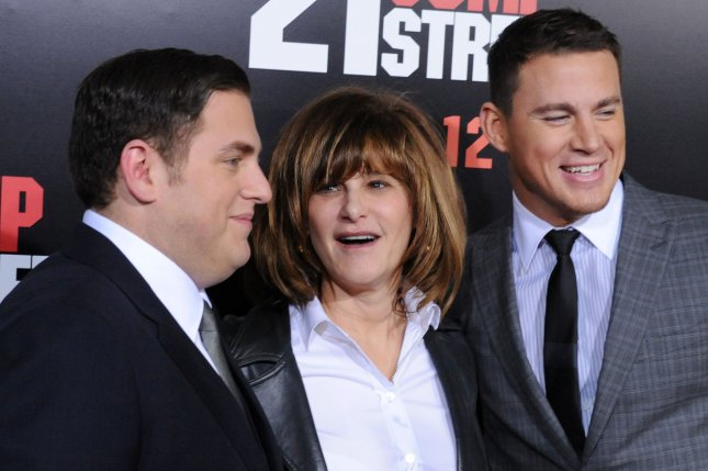 Actors Jonah Hill (L) and Channing Tatum pose with Amy Pascal, the former Co-Chairman of Sony Pictures Entertainment. File photo by Jim Ruymen/UPI
