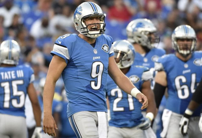 Matthew Stafford finished off the Detroit Lions' latest fourth-quarter comeback with one glove on and two feet in the end zone as the Lions edged the Chicago Bears 20-17 on Sunday at Ford Field. Photo by David Tulis/UPI
