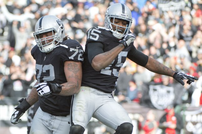 Oakland Raiders receiver Michael Crabtree (15) celebrates with Donald Penn (72) after catching a TD pass from QB Derek Carr in the second quarter against the Kansas City Chiefs at O.co Coliseum in Oakland, California on December 6, 2015. File photo by Terry Schmitt/UPI