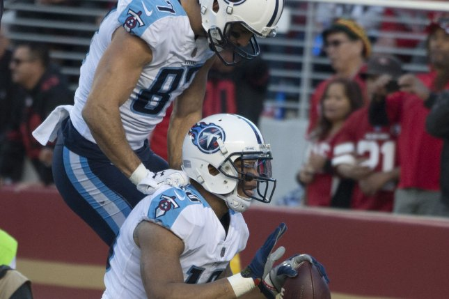 Former Tennessee Titans wide receiver Eric Decker (87) jumps on Rishard Matthews after Matthews caught a 12 yard pass from QB Marcus Mariota in the fourth quarter against the San Francisco 49ers on December 17 at Levi's Stadium in Santa Clara, Calif. Photo by Terry Schmitt/UPI