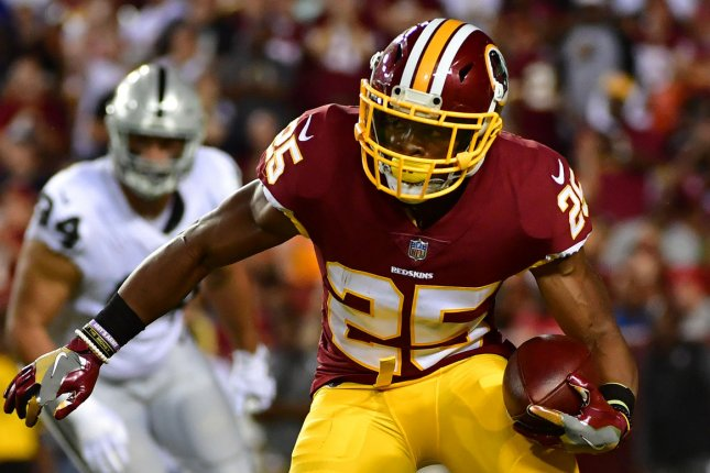 Washington Redskins running back Chris Thompson takes off during a game against the Oakland Raiders at FedEx Field in Landover, Maryland on September 24, 2017. Photo by Kevin Dietsch/UPI
