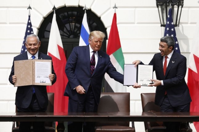 U.S. President Donald Trump, Israeli Prime Minister Benjamin Netanyahu and United Arab Emirates foreign minister Sheikh Abdullah bin Zayed Al Nahyan participate in a signing ceremony for the Abraham Accords, on the South Lawn of the White House in Washington, D.C., on September 15. File Photo by Yuri Gripas/UPI