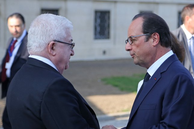 French President Francois Hollande (R) and Iraqi President Fouad Massoum attend the Conference for Peace and Security in Iraq at the Ministry of Foreign Affairs in Paris on September 15, 2014. The conference aims to gain support for an international alliance against radical terrorist groups, particularly the Islamic State (ISIS). UPI/David Silpa