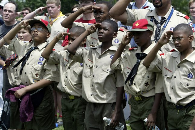 Scouts from Pack 235 salute during the raising of the American Flag during a ceremony at Jefferson Barracks Natoinal Cemetery in St. Louis County, Mo. on May 30, 2004. Thursday, Boy Scouts President Robert Gates indicated the longstanding policy against openly gay adult leaders will be upended. File Photo by UPI Photo/Bill Greenblatt.