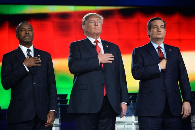(L-R) Ben Carson, Donald Trump and Ted Cruz assemble for a photo-op prior to the fifth Republican presidential candidates' debate at the Venetian Hotel & Casino in Las Vegas, Nevada on December 15. Trump said a maniac in North Korea posed a problem for the United States. Photo by Jim Ruymen/UPI
