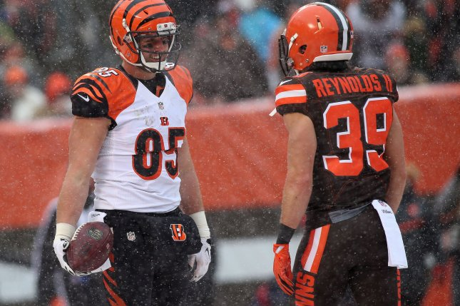 Cincinnati Bengals' Tyler Eifert has works with Cleveland Browns Ed Reynolds II after scoring a touchdown during the second quarter at FirstEnergy Stadium in Cleveland on December 11, 2016. Photo by Aaron Josefczyk/UPI