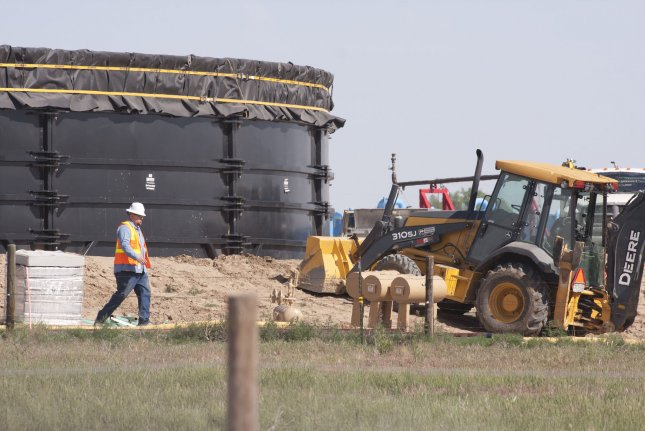 Total U.S. oil production could hit 12 million barrels per day, though federal estimates rely on some uncertainties. File photo by Gary C. Caskey/UPI