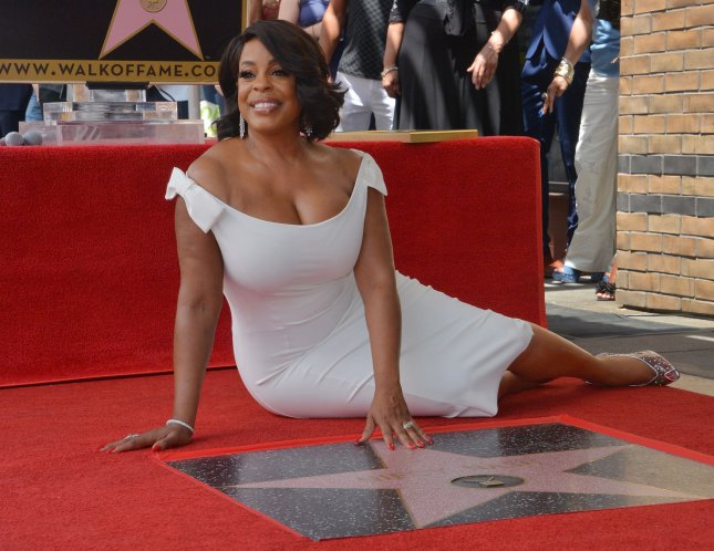 Actress Niecy Nash touches her star during an unveiling ceremony honoring her with the 2,639th star on the Hollywood Walk of Fame in Los Angeles on July 11, 2018. Photo by Jim Ruymen/UPI