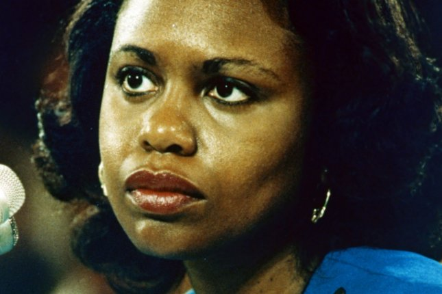 Anita Hill testifies to the Senate on sexual harassment accusations against Supreme Court nominee Clarence Thomas in 1991. UPI File Photo