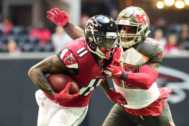 Atlanta Falcons wide receiver Julio Jones (11) makes a first down reception in front of Tampa Bay Buccaneers outside linebacker Kwon Alexander (58) during the first half on October 14, 2018 at Mercedes-Benz Stadium in Atlanta. Photo by David Tulis/UPI