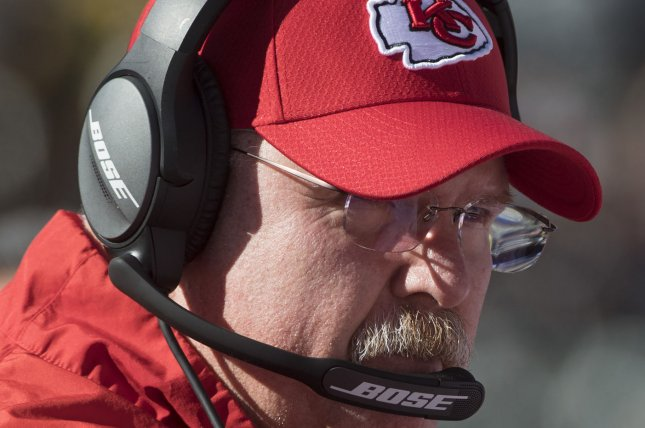 Kansas City Chiefs head coach Andy Reid talks with a player in the first quarter against the Oakland Raiders on December 2 at the Coliseum in Oakland, Calif. Photo by Terry Schmitt/UPI
