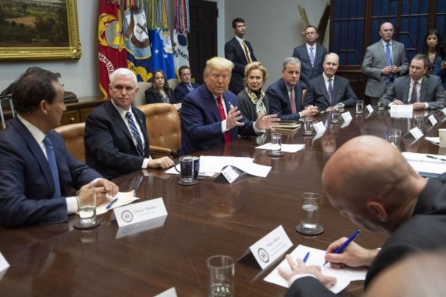 President Donald Trump speaks alongside Vice President Mike Pence, second from left,as they meet with airline CEO about the coronavirus outbreak at the White House on Wednesday. Photo by Kevin Dietsch/UPI