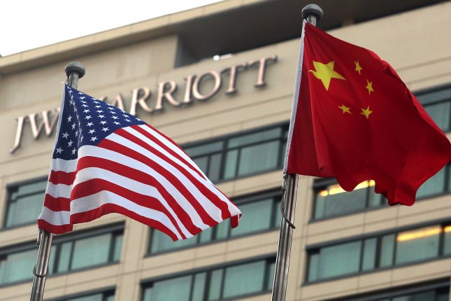 The U.S. and Chinese national flags are seen outside of a hotel in Beijing, China, on August 11, 2020. File Photo by Stephen Shaver/UPI