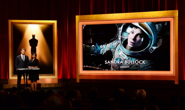 The Oscar nominees for Best Actress including Sandra Bullock for Gravity are announced by actor Chris Hemsworth (L) and Academy of Motion Picture Arts and Sciences President Cheryl Boone Isaacs at the Samuel Goldwyn Theatre in Beverly Hills, California on January 16, 2014. The 86th annual Academy Awards will take place March 2. UPI/Jim Ruymen