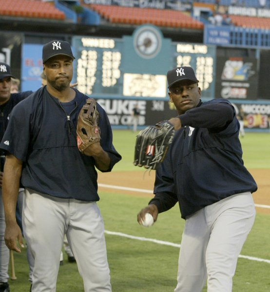 Bernie Williams, left, and Ruben Sierra are shown prior to a game in 2003 when both were members of the New York Yankees. They have been added to the 2012 Baseball Hal of Fame ballot, it was announced Wednesday (UPI/MICHAEL BUSH)