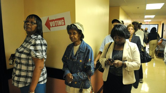 Voters wait to cast their ballots. UPI/Kevin Dietsch