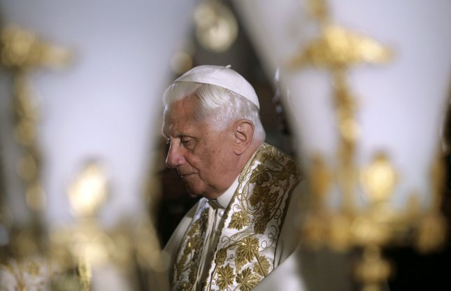 Pope Benedict XVI stands in front of the Stone of Anointing,where Christians believe the body of Jesus was prepared for burial, in the Church of the Holy Sepulcher in Jerusalem on May 15, 2009. (UPI Photo/Yannis Behrakis/Pool)