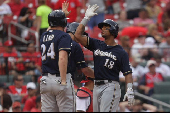 Milwaukee Brewers' Khris Davis is congratulated at home plate after hitting a three run home run in the ninth inning against the St. Louis Cardinas at Busch Stadium in St. Louis on September 27, 2015. The home run was Davis' second on the day as Milwaukee defeated St. Louis 8-4. Photo by Bill Greenblatt/UPI